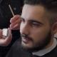 Barber Works On Client's Beard