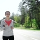 Health Sport Young Woman Run And Look Wear Smart Watch Device