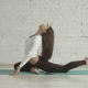 Beautiful Young Woman Doing Yoga Exercise One-Legged King Pigeon Pose