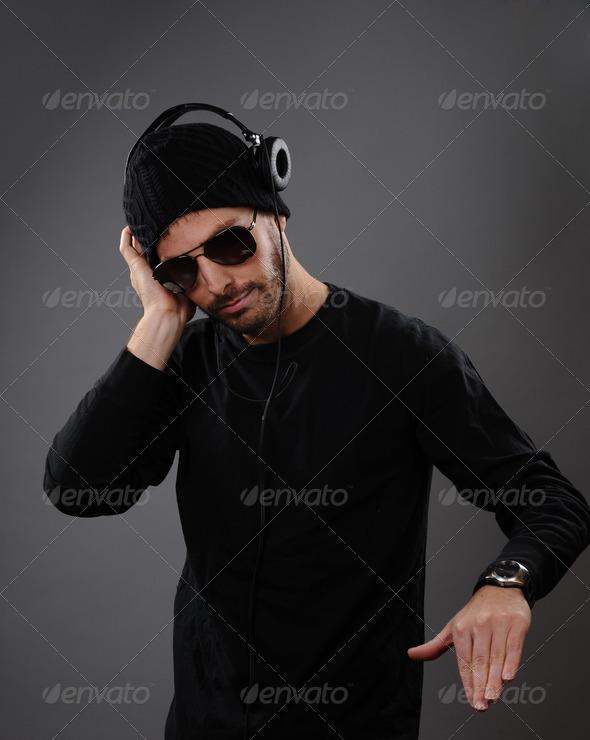 DJ with headphones - Stock Photo - Images