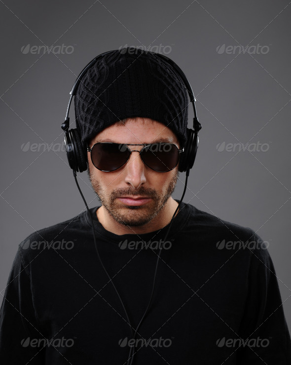 PhotoDune Serious DJ with headphones 1618539