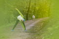 Sporty woman  working out in forest.