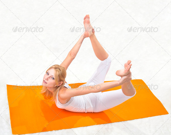 Young beautiful girl is professionally engaged in yoga - Stock Photo - Images