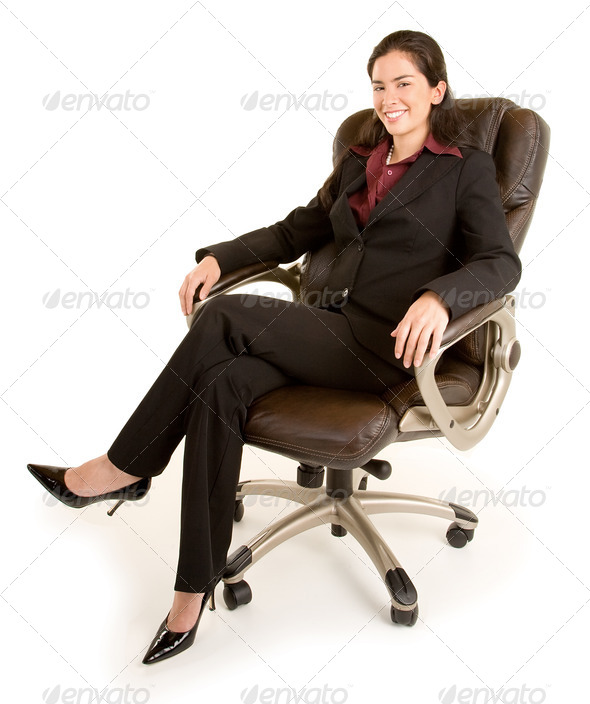 Smiling Businesswoman Sitting on a Leather Chair - Stock Photo - Images