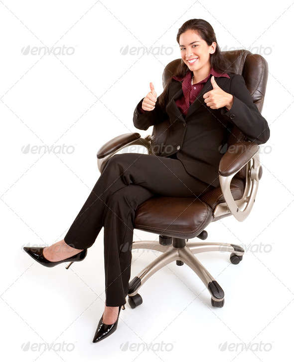 Businesswoman Sitting on a Leather Chair with Thumbs Up - Stock Photo - Images
