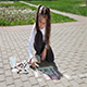Little Girl Drawing on Pavement With Chalk
