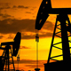 Silhouette Of Crude Oil Pump At Sunset In Oil Field - 2