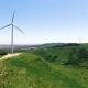 Wind Power Plants On a Green Hills Aerial Drone