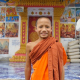Novice Monk Walking And Smiling