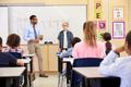 Schoolboy presenting to his elementary school classmates
