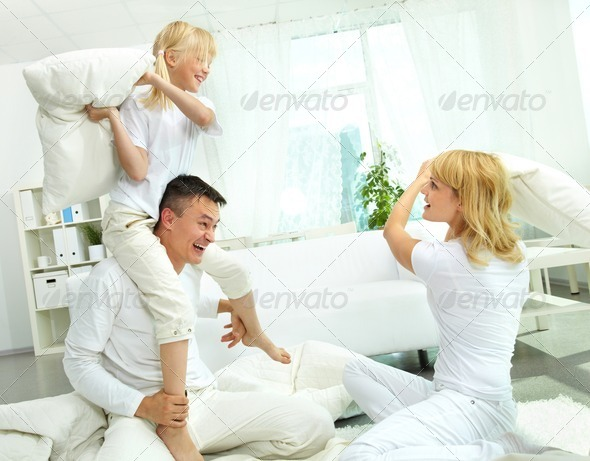 Family pillow fight - Stock Photo - Images