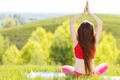 Young woman doing yoga pose outdoor in the morning
