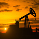 Silhouette Of Crude Oil Pump At Sunset In Oil Field - 4