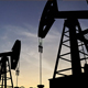 Silhouette Of Crude Oil Pump At Sunset In Oil Field - 3