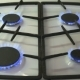 Four Gas Burners Burn Blue Flame On a Gas Stove