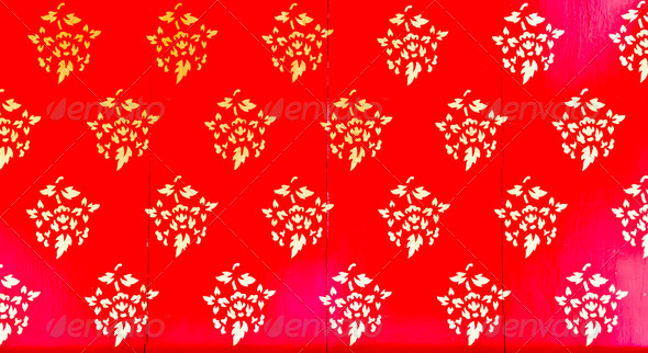 Golden Thai pattern on red - Stock Photo - Images