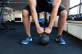 Bodybuilder working out with kettlebell