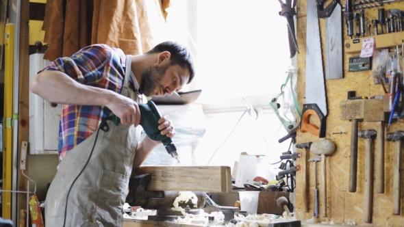 Man With Drill Poraus Puu Plank At Workshop 3 - People Arkistofilmit