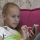 Young Girl Using Smartphone At Home 07