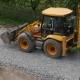 Excavator Carries Gravel In The Bucket