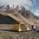 Woman Setup a Tent In The Mountains