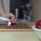 Woman Hand Cut Radish Vegetables On Cutting Board For Salad.