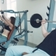 Man Doing Inclined Bench Press Then Drinking Water And Exercising Again