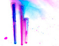 test tubes with colorful substances spilled on a white table in