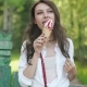 Portrait Of Young Happy Woman Eating Ice-cream, Outdoor