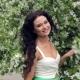 Young Beautiful Brunette Woman In Blooming Garden