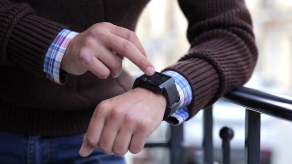 Download Man in the City Using Smart Watches  nulled download