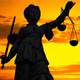 Statue of Lady Justice With a Colorful Sunset Background