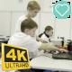 Children Work On a Computer To Create a Robot