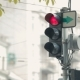 Traffic Light In The City. Flashing Red, Yellow And Green Lights