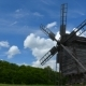 Old Windmill And Floating Clouds