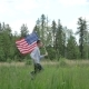 Happy Boy With American Flag Running
