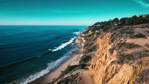 VideoHive Deserted Wild El Matador Beach Malibu California Aerial Ocean View Waves with Rocks 19000187