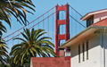 Architectural fragments of famous Golden Gate Bridge and wooden house.