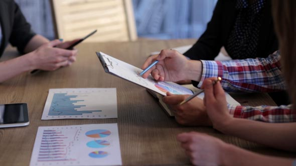Download Businesspeople Discussing Charts nulled download