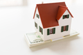 close up of home or house model and money