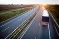 highway traffic - motion blurred truck on a highway/motorway/spe