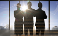 business people silhouettes with chart and numbers