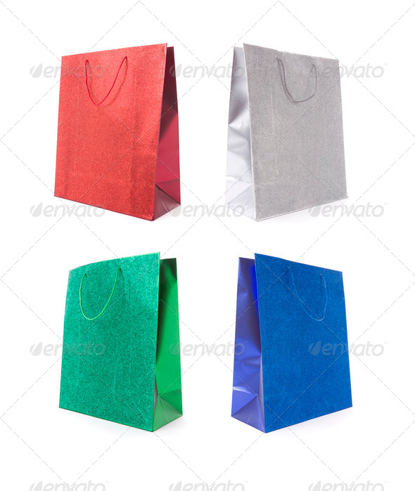 Set of Four Multicolored Glitter Gift Bags on a White Background. - Stock Photo - Images