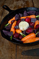 Root Vegetables in a Cast Iron Skillet on a wood table - PhotoDune Item for Sale
