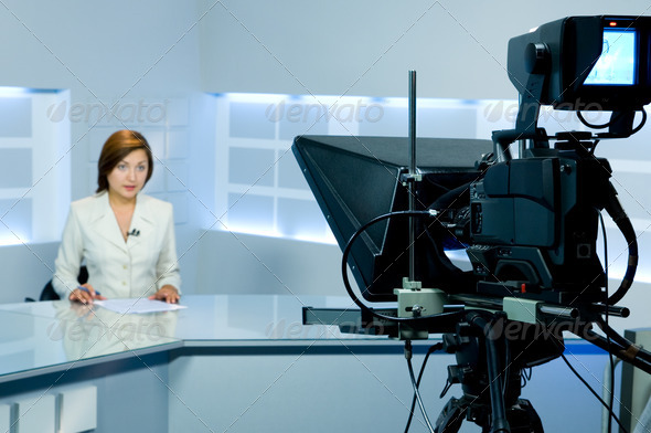 PhotoDune television anchorwoman during live broadcasting 1657589