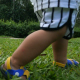 Little Boy's Foot Stepping On The Grass