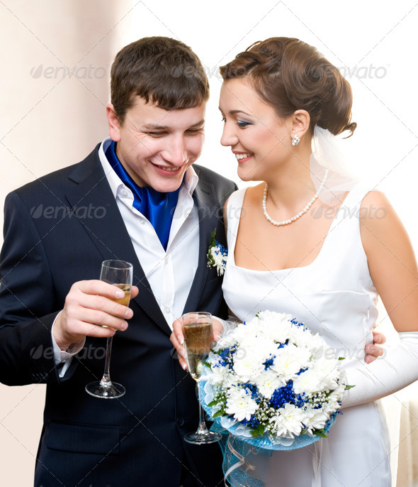 bridegroom and bride with champagne - Stock Photo - Images