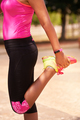 Woman Sports Stretching Using Fitwatch Steps Counter