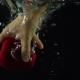 Man Hand Reaches And Grabs Red Apple Floating Under Water Super  Shot