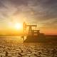 Oil Pump Jack Dramatic Sky Over Cracked Earth Landscape